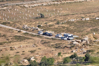 Photo: Cars of visitors before the roadblock, seen from the hilltop