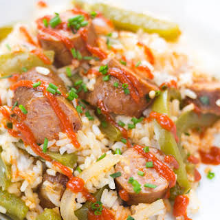 Slow Cooker Sausage and Peppers over Rice.