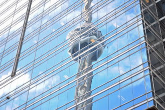 Photo: The CN Tower reflected from a skyscraper in downtown Toronto during G20 Summit weekend.