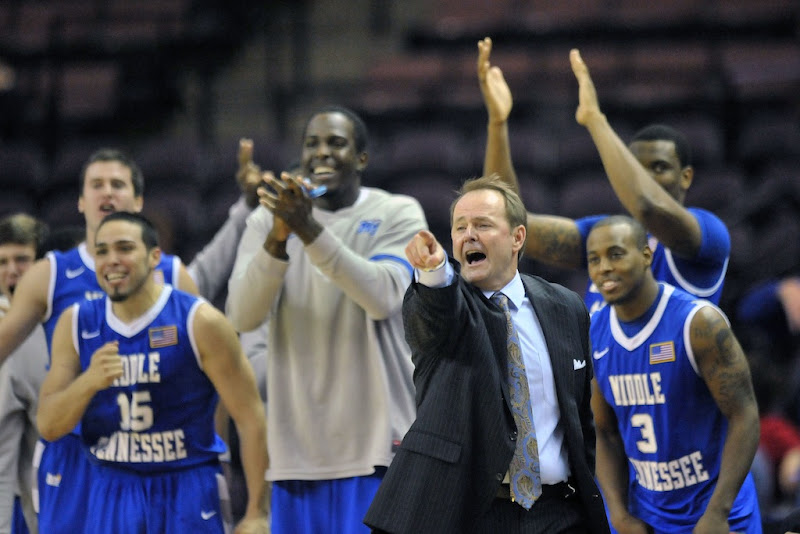 Photo: Dec 21, 2011; Southhaven, MS, USA; Middle Tennessee Blue Raiders head coach Kermit Davis and the Middle Tennessee bench celebrates scoring against the Ole Miss Rebels during the second half at DeSoto Civic Center. Middle Tennessee defeated Mississippi 68-56. Mandatory Credit: Jim Brown-US PRESSWIRE