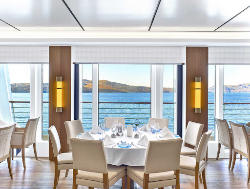 Viking-Ocean-Ship-The-Restaurant-window.jpg - Watch the passing landscapes from the Restaurant, the main dining venue on your Viking ocean ship.