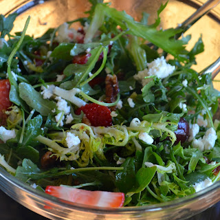 Frisée & Arugula Salad with Grapes, Strawberries & Goat Cheese.