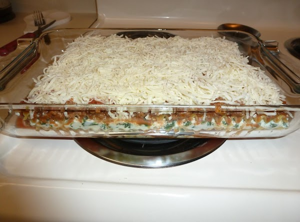 Spread half the cheese filling topped with 1/3 the meat sauce then another layer...