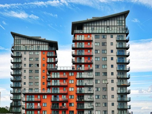 A picture containing sky, outdoor, tall, apartment building  Description automatically generated