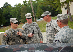 "Photo: Lt. Col. Kelli Hammond (second from the left), who commands more than 150 troops from the 19th CERF-P, is participating in the Vibrant Response Exercise at the Muscatatuk Urban Training Complex (MUTC), in Indiana, to train for a real-world response to a catastrophic event, Aug 10-14, 2013.  Hammond is arranging for movement of Field Search and Recovery Teams (FSRT) on site.  The overarching mission of the Vibrant Response Exercise is to save lives and mitigate suffering, but the reality is that fatalities still occur in real-world situations.  ""While the other areas are focused on the living, fatality recovery is still highly critical and it is an added mission that could not otherwise be done,"" said Hammond.  (U.S. Air National Guard photo by Staff Sgt. Jennifer Rechtfertig/Released)"