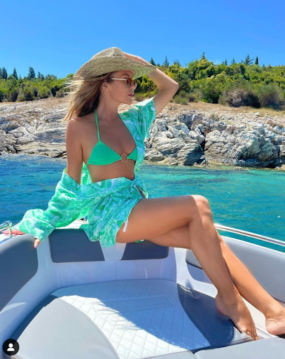 Amanda Holden, 50, wows fans in a tiny green bikini as she reveals she's jetted off on a family holiday