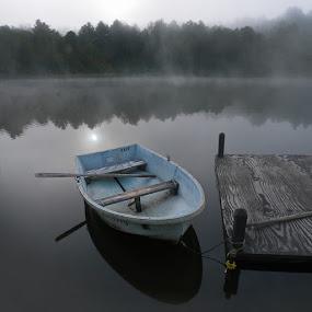 by Marianna Armata - Transportation Boats ( water, reflection, forest, lake, marianna armata, morning, boat, oar, dock, sun, row, blue, fog, sunrise )