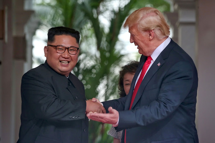US President Donald Trump and North Korea's leader Kim Jong-un walk together to attend their summit at the Capella Hotel on the resort island of Sentosa, Singapore, this week. Picture: REUTERS