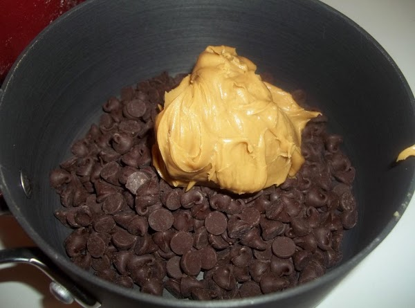 In small saucepan, melt 1-1/2 cups chocolate chips with 1/3 cup peanut butter. ...