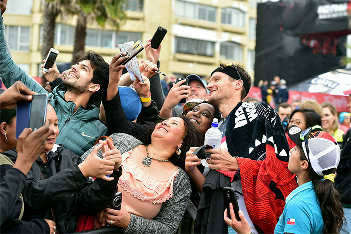 2 September 2018 - The Isuzu Ironman 70.3 World Championship in Nelson Mandela Bay. Winner of the men's event Jan Frodeno takes a selfie with spectators