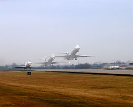 Photo: Commercial jet taking off three positions