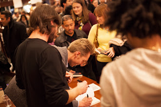 Photo: Signing books in NYC (photo by Spyr Media)