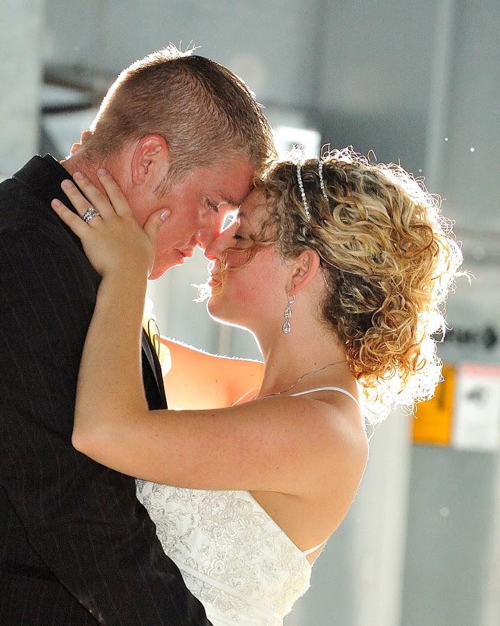 Bride and Groom at night  by Brett Paul - Wedding Reception