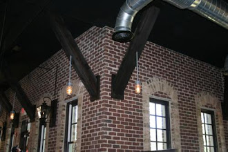 Photo: Gas Lights And Vapor Lights Inside Of Restaurant