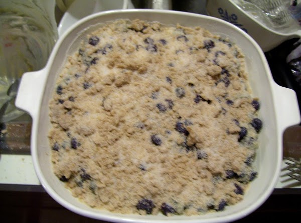 After adding more Blueberries to the top of my batter, I made the Crum topping ans just sprinkled it over the top of the Batter, evenly. Place in the Oven and bake @ 375. If Your Berries are Not at room temp, add more baking time. about 15 min more then check.