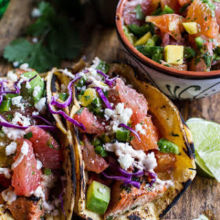 Cuban Fish Tacos with Citrus Mango Slaw + Chipotle Lime Crema..