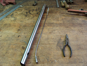 Photo: The top tube and internal cable guide, ready to be brazed in.