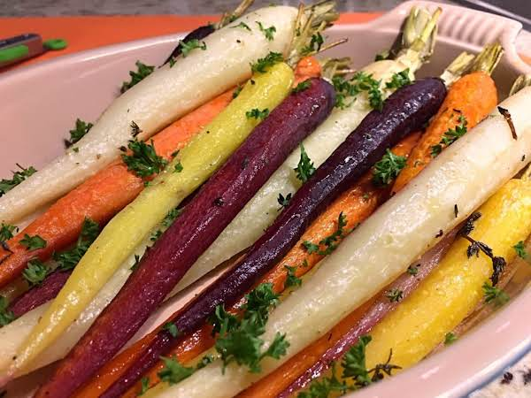 A Bunch Of Rainbow Carrots On A Serving Dish.