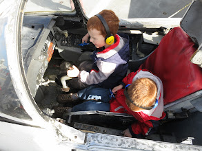 Photo: New way to save money on airplanes - make 1 seaters into 2 seaters by using 5 year old pilots.