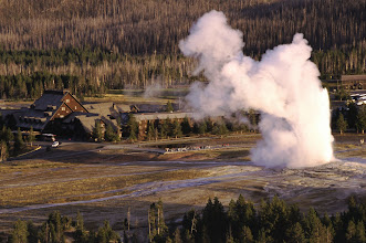 Photo: Old Faithful Geyser erupts in front of Old Faithful Inn - Yellowstone National Park, Wyoming
