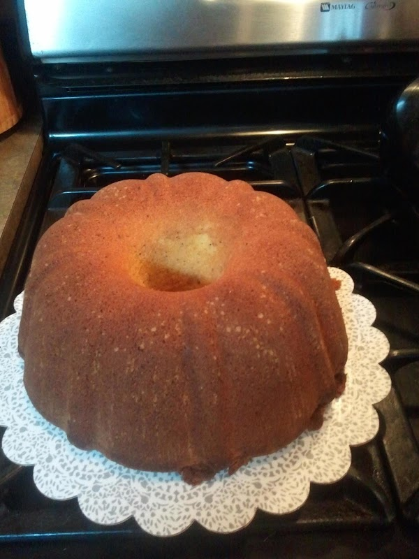 Frost cake as desired. I used  canned cream cheese frosting & Pastel colored...