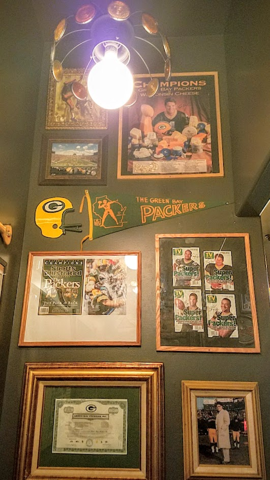 When you walk through that door of Saraveza, you immediately feel a bit like you're in a beer museum with all the retro beer paraphernalia all along the walls even on the way to the restrooms -one portion is a nod to owner Sarah's Wisconsin upbringing and how this is a Packers bar