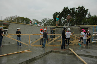 Photo: Getting ready to push up the first roof truss.