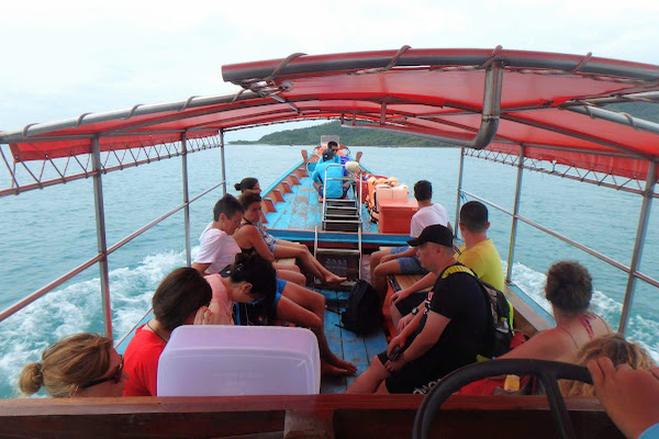 Head by longtail boat to Koh Tan