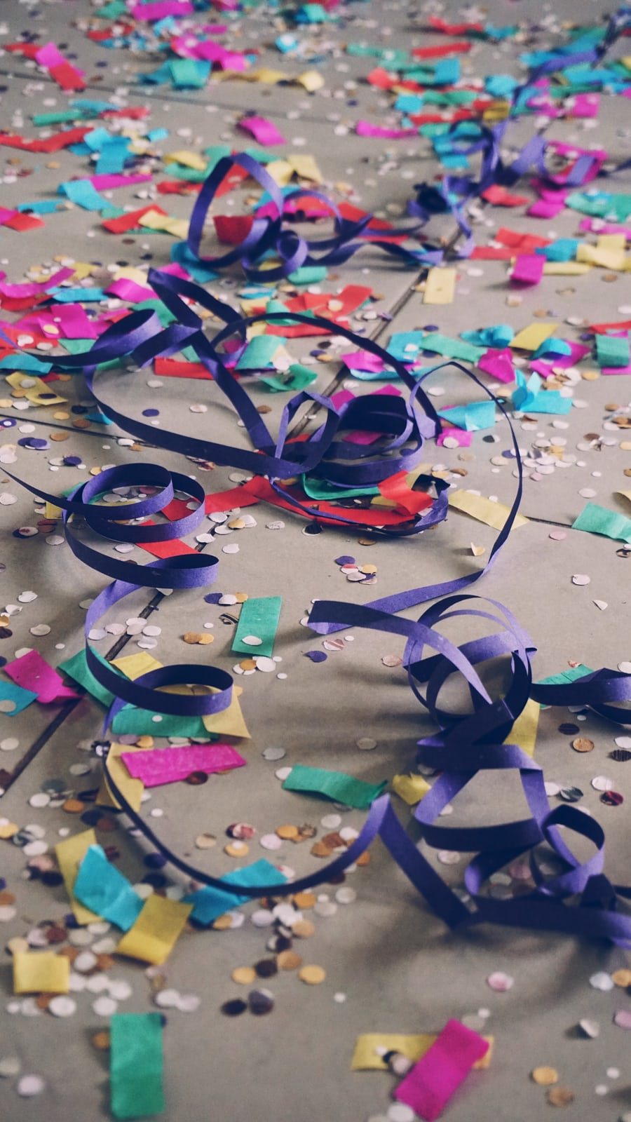 different types of confetti scattered on the floor