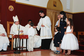 Photo: Cristian and Gabriela bring up the bread and wine