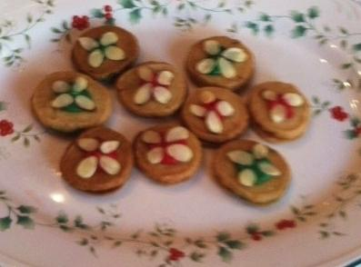 Decorate cookies with icing. Put a small Dollop of icing on top of cookie. ...