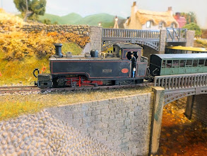 Photo: 018 Another very individual and impressive locomotive passes through Avyn-A-Llyin. This is a Hunslet 2-6-4 that has found its way to North Wales all the way from India. I do not know the provenance of this very well made model, but something at the back of my mind is suggesting Arthur Belshaw and his erstwhile Lambton Engine Works to me. Can anybody provide information about this splendid model please? ,