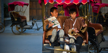 """Photo: Cart Runners in Old Beijing  There are many old pockets scattered all over Beijing.  I haven't become totally familiar with all the names of these quadrants yet, but I should get another chance to re-visit all these places.  This is actually kind of a weakness in the whole """"travel blog"""" thing.  See, a REAL travel blogger would memorize the names of all these places and spout them back to you.  But, here is my excuse... and maybe it is not really that bad... but, to me, this kind of photo could be taken in many different places.  The exact neighborhood does not matter.  In fact, by NOT telling you the spot, you may be more likely to find it just by wandering about.  These uniformed guys sat together in between jobs and had a rest.  I don't know what struck me about it, but it just seemed like a nice little moment.   from Trey Ratcliff at www.stuckincustoms.com"""