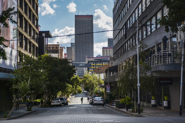 Commercial office buildings, including the Transnet offices, center, stand on the skyline of Johannesburg on Monday April 6 2020 during a nationwide lockdown. Picture: BLOOMBERG/WALDO SWIEGERS