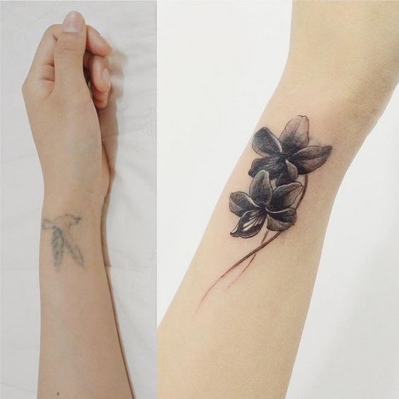 flower cover up tattoos on wrist