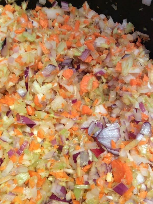 Chop leeks carrots onions and celery. I really like to use a food processor...