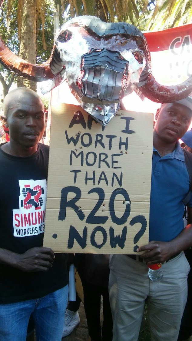 Khongelani Hlongwane and Thabang Mohlala of the Casual Workers Advice Office during the march against the minimum wage in Newtown, downtown Johannesburg.