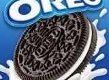 Crush 1 regular sized bag of Oreo cookies with a rolling pin between two...