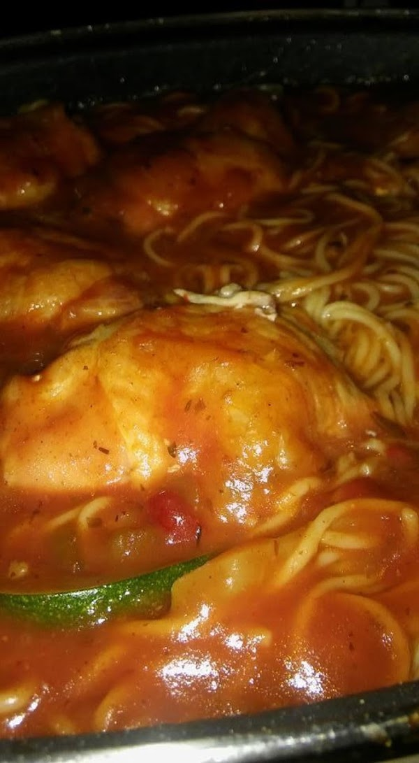 Dip each piece of chicken into the sauce on both sides as you add...
