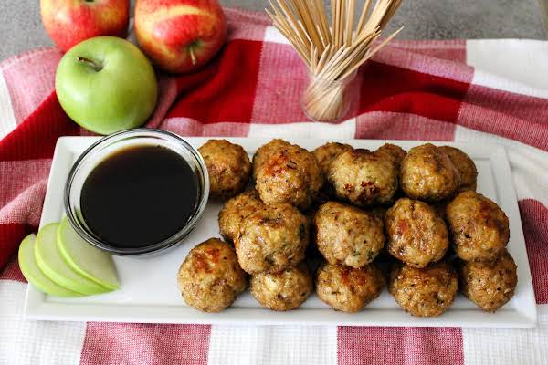 A Platter Of Apple Turkey Meatballs With Balsamic Glaze On The Side.