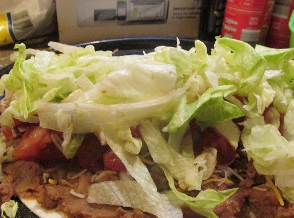 Top with shredded lettuce.