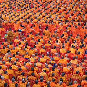 Sea of Orange by John Greene - People Group/Corporate ( orange, 10, central world, monks, praying, buddhist, thailand, 000, people, crowd, humanity, society )