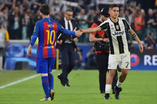 a4d19c55d8d Juventus  forward from Argentina Paulo Dybala (R) shakes hands with  Barcelona s Argentinian forward