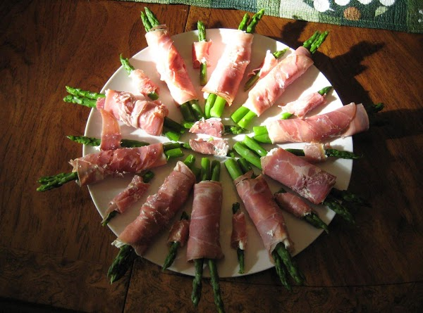 Drain and dry asparagus spears.  Spread cream cheese mixture onto prosciutto slices in...