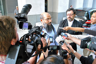 Photo: Mohammad Mahjoub addresses questions from the media during the lunch recess.
