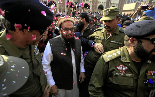 Hafiz Saeed walks to court before a Pakistani court ordered his release from house arrest in Lahore, in November 2017. Picture: REUTERS