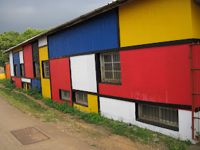 "Photo: Jyh-min's family farm on a plateau in central Taiwan.  This is the ""barn,"" which was painted as part of a community effort to promote agro-tourism."