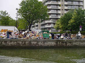 Photo: We pass by a street market, seeing mostly the discarded containers on the Canal edge.