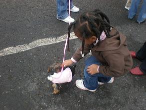 Photo: Kaleya pets this cute little dog