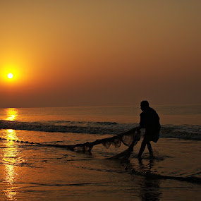 The Sea, The Fisherman and The Dawning Sun by Rana Dasgupta - Professional People Factory Workers ( pwc silhouettemotion )
